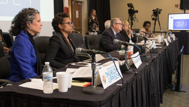 Jacqui Thurlow-Lippisch, left, and fellow Constitution Revision Commission commissioners listen during a public hearing on proposals under consideration held at the University of West Florida in Pensacola on Tuesday, February 27, 2018. In April, commissioners voted not to allow Floridians to consider a proposed constitutional amendment to end the state's write-in loophole.