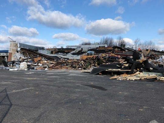 Construction workers demolish the Red Oak Diner on