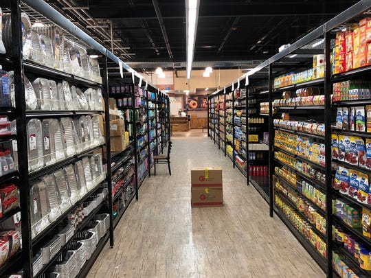 A look down an aisle, that includes housewares, at