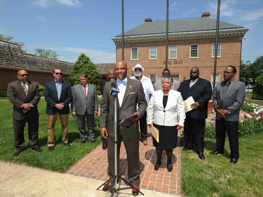 Lamar Gunn (center), president of the Central Delaware NAACP, speaks at a press conference Tuesday at City Hall in Dover concerning the arrest of Dover policeman Cpl. Thomas W. Webster IV, who was arrested on assault charges after a grand jury indicted him for kicking a man in the face and breaking his jaw during an arrest at gunpoint in 2013.