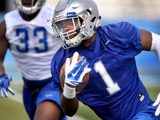 MTSU's running back Shane Tucker runs the ball during the first fall practice Thursday, August 6, 2015.
