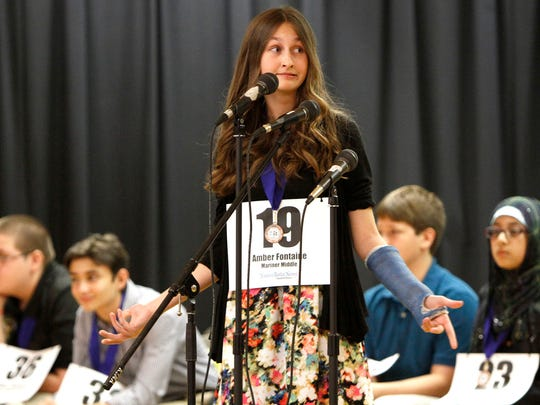 Amber Fontaine asks the judges a question at the Lee County Middle School Spelling Bee Thursday, March 19 in Fort Myers.