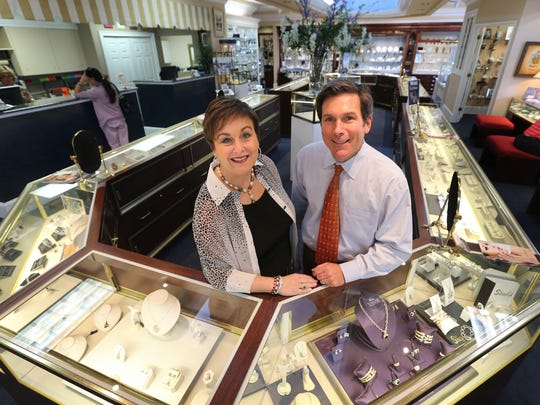 Lisa Tidwell Halliburton, left and her brother Greg Tidwell, right the owers of Bell Jewelers in Murfreesboro stand in their showroom.