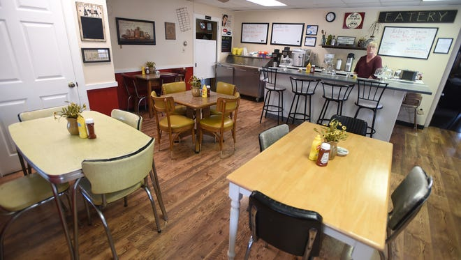 On April 20, 2016, the Olde Willow Tree Cafe  opened its door for business in the space once occupied by the Kold Duck Kafe at 20 N. College St., Myerstown. Owner Denise Fisher applies the finishing details to cafe on April 19.