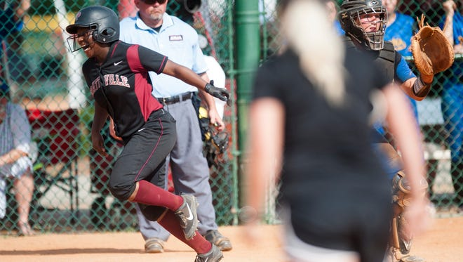 Prattville's Antinique Clay scores on an infield hit that scored four runs during the AHSAA State Softball game between Fairhope and Prattville on Thursday, May 18, 2017, in Montgomery, Ala.