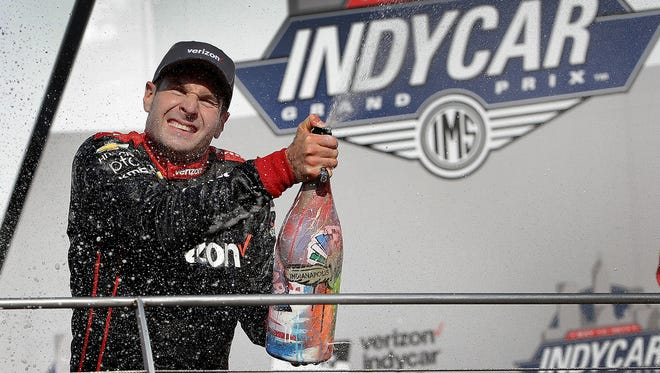 Team Penske  IndyCar driver Will Power (12) sprays and gets sprayed with champaign as he celebrates his winning the IndyCar Grand Prix Saturday, May 13, 2017, afternoon at the Indianapolis Motor Speedway.