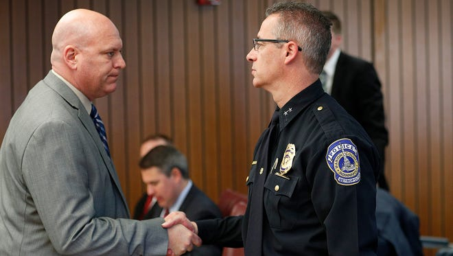 IMPD Chief Bryan Roach greets FOP President Richard Snyder,left, before the start of the hearing.Two Indianapolis police officers who last summer fatally shot unarmed black motorist Aaron Bailey appeared before the Civilian Police Merit Board on Tuesday, May 8, 2018.