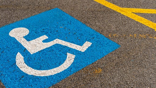 A parking spot designated as accessible for the disabled.