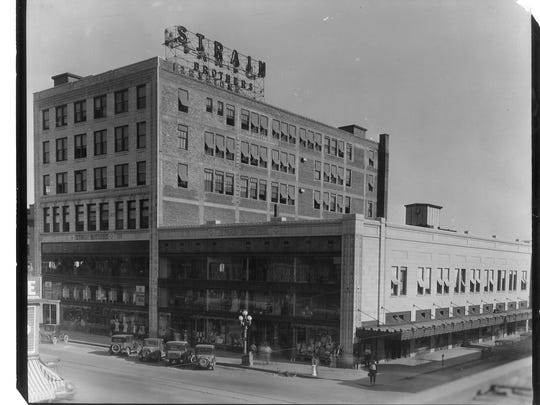 The Strain Building, circa 1929, comprised three adjoining buildings, a six-story office building and a three-story retail building