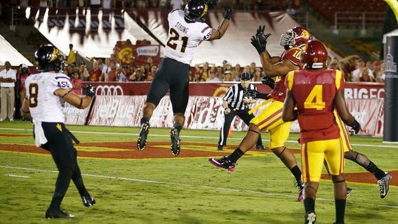 """Arizona State's Jaelen Strong catches a 49-yard """"hail mary"""" pass from Mike Bercovici to defeat USC on the final play of the game on Saturday, Oct. 4, 2014 at Memorial Coliseum in Los Angeles, CA."""