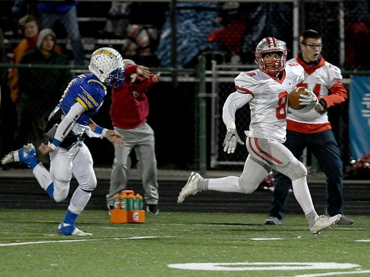 Shelby's Devon Brooks runs for a 74-yard touchdown Friday night in the second quarter during their playoff game with Philo at Westerville North High School.