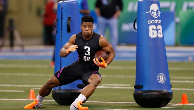 Penn State Nittany Lions running back Saquon Barkley goes through workout drills during the 2018 NFL Combine at Lucas Oil Stadium.