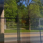 Iroquois Park is reflected in a window of the old Colonial Gardens as the building sits unused on the corner of Kenwood Avenue and New Cut Road. The old building used to be a restaurant, nightclub where Elvis Presley was rumored to have performed and a zoo during the Prohibition Era. By Matt Stone, The C-J May 5, 2015