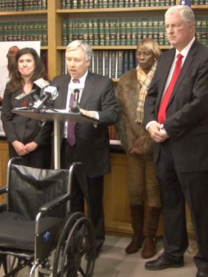 At a press conference announcing a lawsuit filed against the city of Wilmington are (from left) Raeann Warner, Thomas Crumplar, Janie McDole and Thomas Neuberger. Jeremy McDole was shot by Wilmington police officers while he was sitting in his wheelchair.