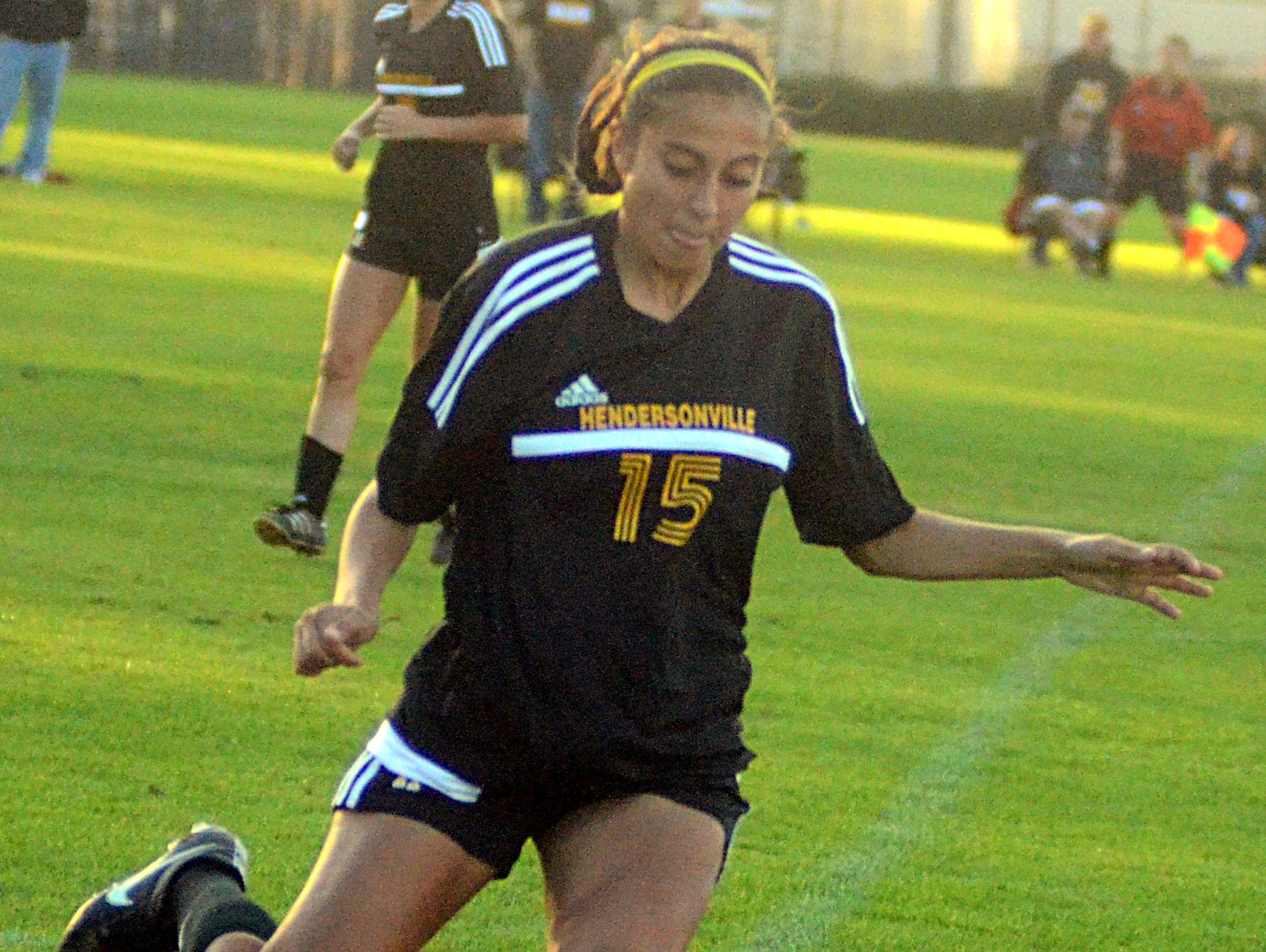 Hendersonville High junior Claire Almaraz clears the ball from her own end during first-half action.