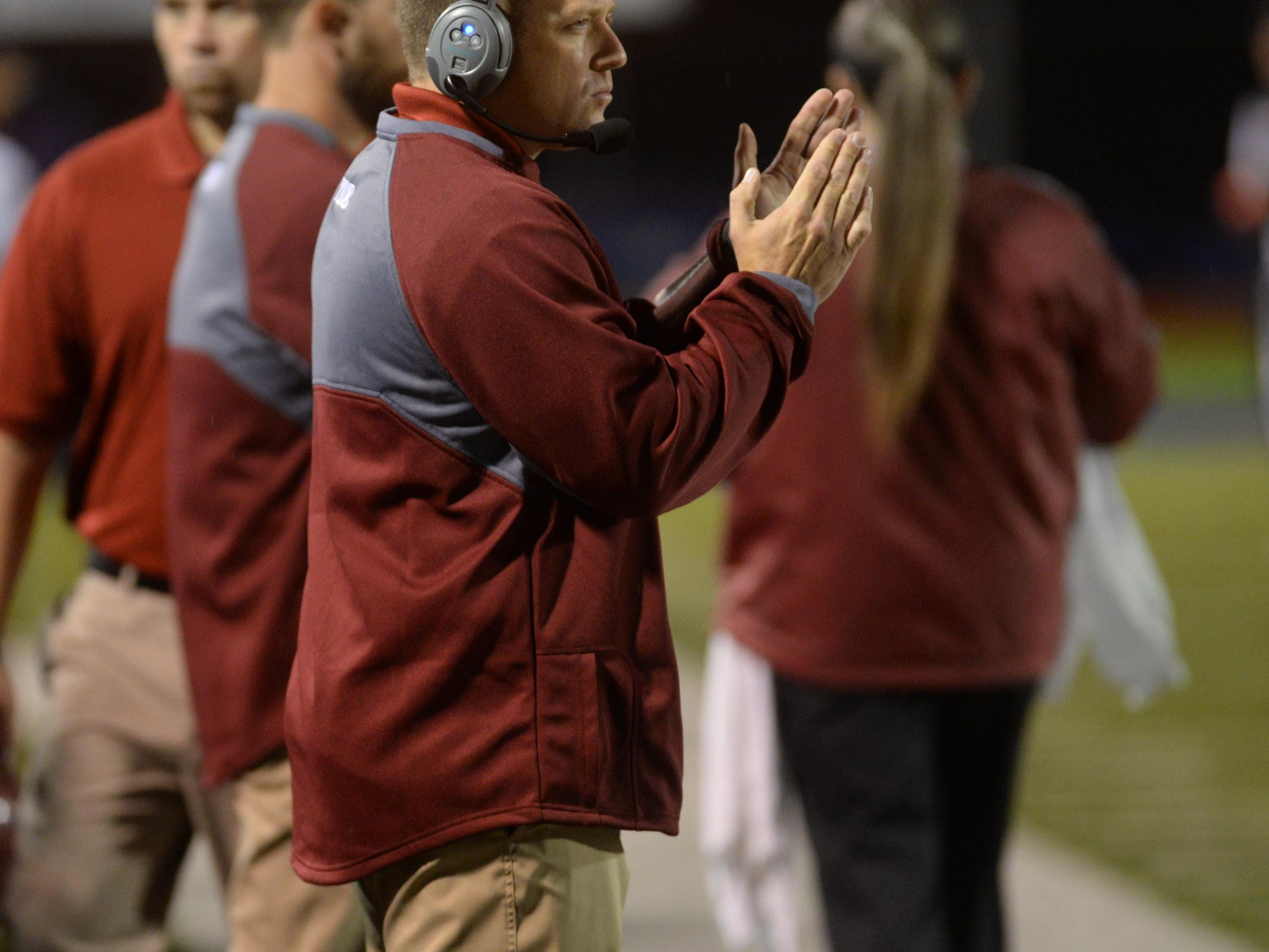 Minden head coach James Heard watches from the sideline while taking on North DeSoto.