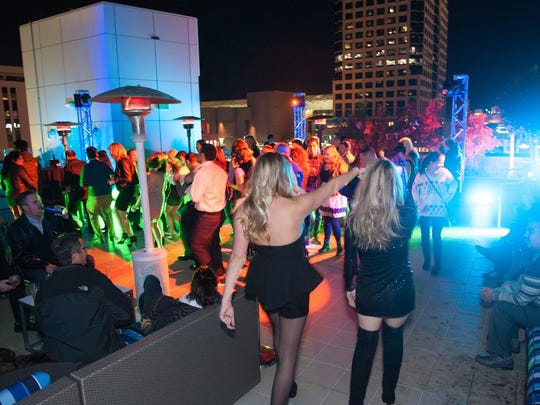 The dance floor draws them in like a magnet during the Up On the Roof New Year's Eve Party at Lustre in Phoenix on Dec. 31, 2015.