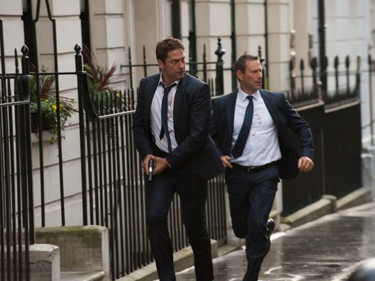 Gerard Butler (left) and Aaron Eckhart try to survive
