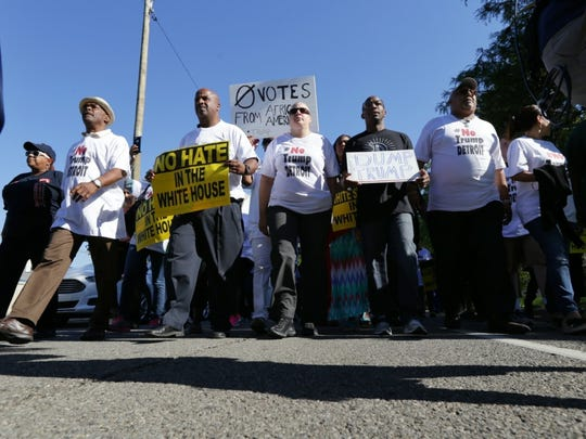Protesters organized by Rev. Horace Sheffield march up Oakman Blvd in Detroit, Michigan to join a demonstration at Great Faith Ministries, where Republican presidential candidate Donald Trump is scheduled to tape an interview with pastor Wayne T. Jackson on Sep 3, 2016.