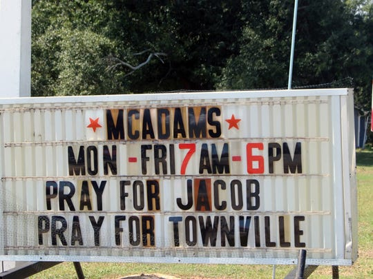 A sign outside McAdam's Grocery in Townville on Thursday encourages people to pray a student who was shot at Townville Elementary School.