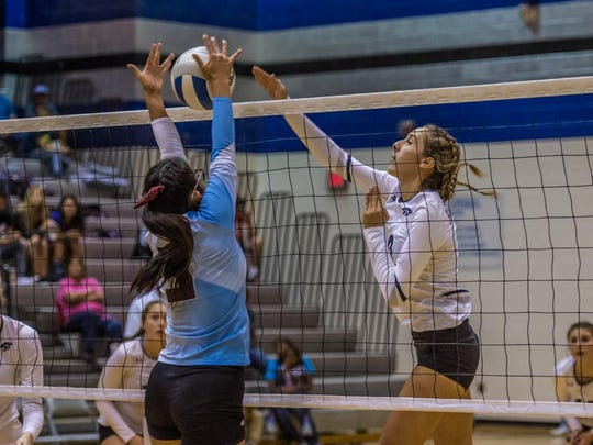 Piedra Vista's Bebe Jaquez records a kill against Ganado, Ariz., during the championship match of the Piedra Vista Invitational on Sept. 10 at the Jerry A. Conner Fieldhouse.