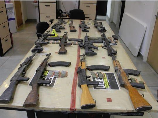 A dozen rifles were seized Sunday during a raid at