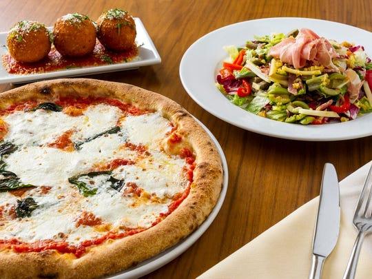 Pizza, salad and meatballs at Stella 34 Trattoria in