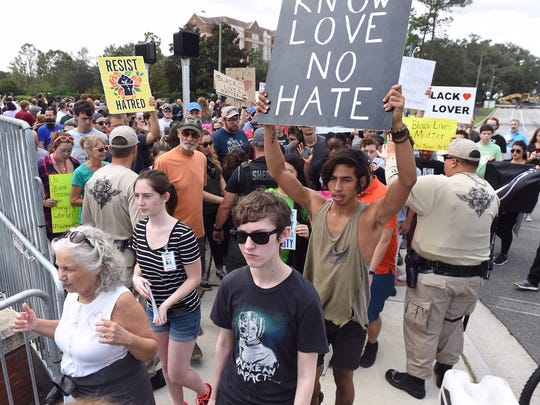 Protesters prepare for the afternoon speech of white nationalist Richard Spencer on the University of Florida campus.