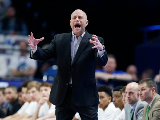 Trinity head coach Mike Szabo shouts instruction against Scott County during a first round game of the Whitaker Bank/KHSAA Boys' Sweet 16 basketball tournament played at Rupp Arena in Lexington, Ky. Wednesday March 14, 2018. (Photo by Gary Landers)
