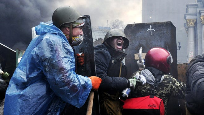Protesters advance to new positions in Kiev on Thursday.