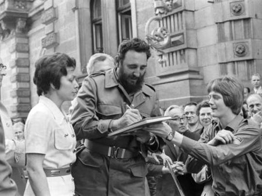 FILE - In this June 1972 file photo, Cuba's leader Fidel Castro autographs a book during his visit to East Berlin in the former German Democratic Republic. Castro has died at age 90. President Raul Castro said on state television that his older brother died late Friday, Nov. 25, 2016.