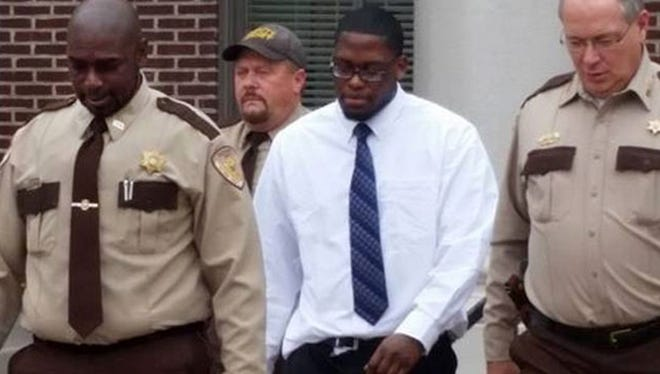 Lawrence Reed (center) is escorted from the Quitman County Courthouse Tuesday, March 10, 2015 in the Marco McMillian murder trial.