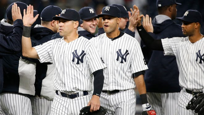New York Yankees' Jacoby Ellsbury, left, Mason Williams, center, and Aaron Hicks celebrate the Yankees' 5-1 win over the Boston Red Sox in a baseball game in New York, Thursday, Sept. 29, 2016.