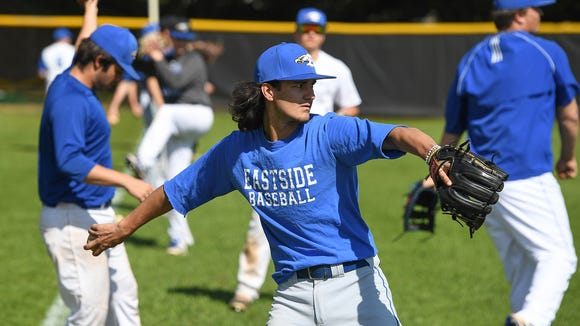 Eastside senior Tank Harrison warms up with the rest of the Eagles' baseball team before their practice on Thursday, April 12 2018 at the school in Taylors.