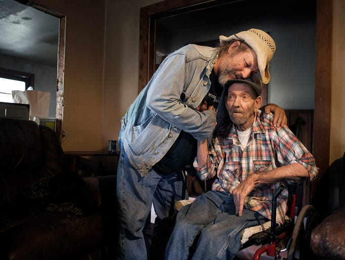 Jack Stoddart embraces Willie Ray Abston, 78, who everyone