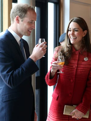 Prince William and Duchess Kate taste whisky during tour of distillery in Scotland on May 29.