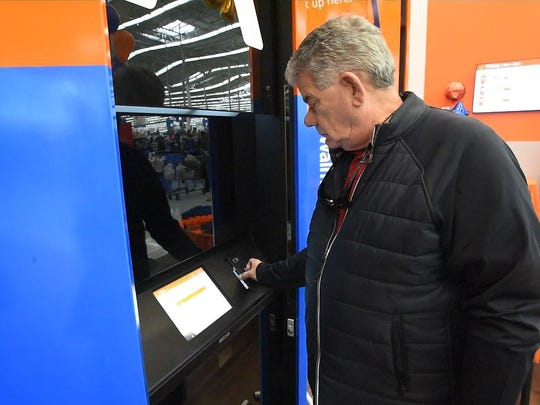 James Fisher of Union City tries to pick up his order at one of the two new pickup towers at Walmart in Seacacus , November 21, 2017.