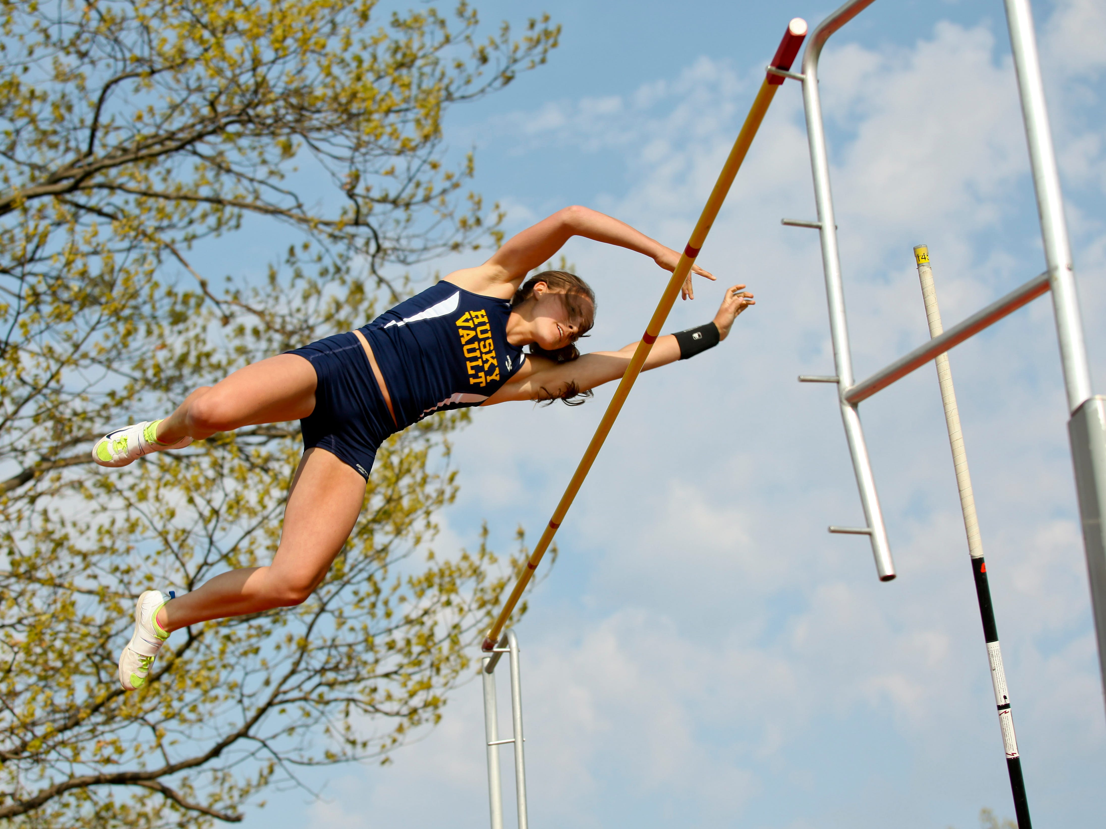 Port Huron Northern junior Mackenzie Shell set a state record in the pole vault Tuesday at Port Huron Northern High School. JEFFREY SMITH/TIMES HERALD.