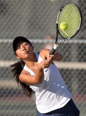 Redwood's Claire Yang returns to Bakersfield's Margo Kuney in the No. 1 singles match of a Central Section Division II championship high school girls tennis match on Tuesday, November 7, 2017. The Rangers are the defending Division II champions.