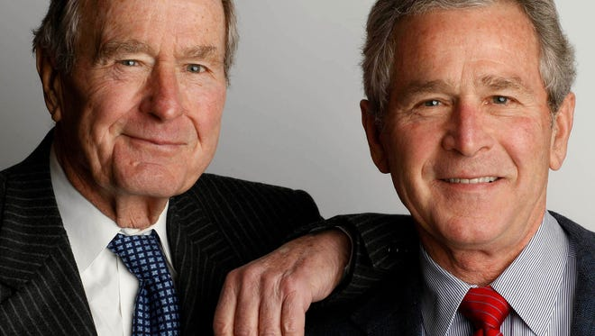 "President George Herbert Walker Bush, left, with his son George W. Bush, author of the book ""41: A Portrait of My Father."""