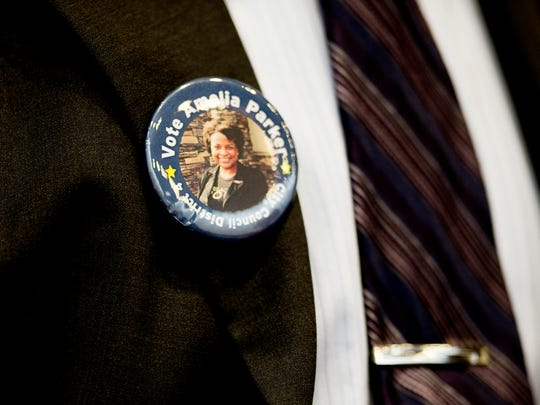An Amelia Parker supporter wears a button during a special meeting to decide the tie for second place among the primary candidates for the 4th District for city council at the City County Building in Knoxville, Tennessee on Wednesday, September 6, 2017. In the end, candidate harry Tindell won the vote.