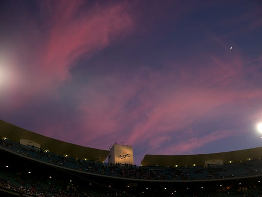 Clouds reflecting colors of the sunset are seen over Dodger Stadium during a game between the Dodgers and the Chicago White Sox on June 2, 2014. (AP Photo/Jae C. Hong)