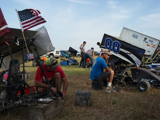 Parents work on their kids' go-karts following the