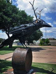 "This large sculpture by Throckmorton artist Joe Barrington is constructed of steel and recycled tires and is titled, ""Messenger Prankster."" It is one of five new additions to the Kemp Center for the Arts sculpture garden exhibit which opens Saturday."