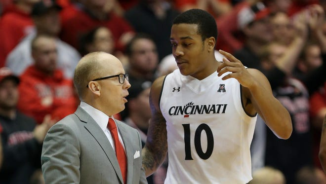 """Head coach Mick Cronin and guard Troy Caupain have suffered three losses this season, all to top 11 teams. """"These are the games that you try to play for in March,"""" Caupain said."""