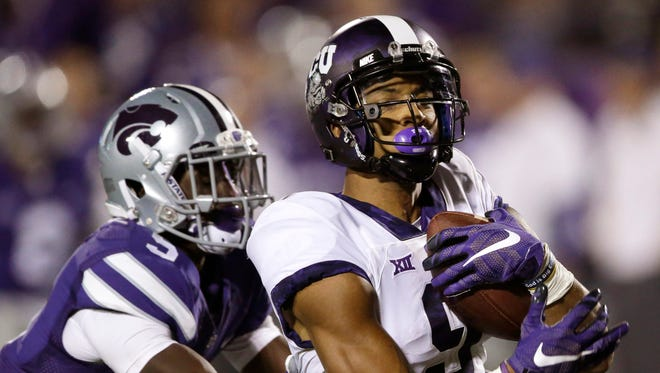 TCU wide receiver Josh Doctson, right, gets past Kansas State defensive back Jesse Mack for a touchdown Oct. 10, 2015.