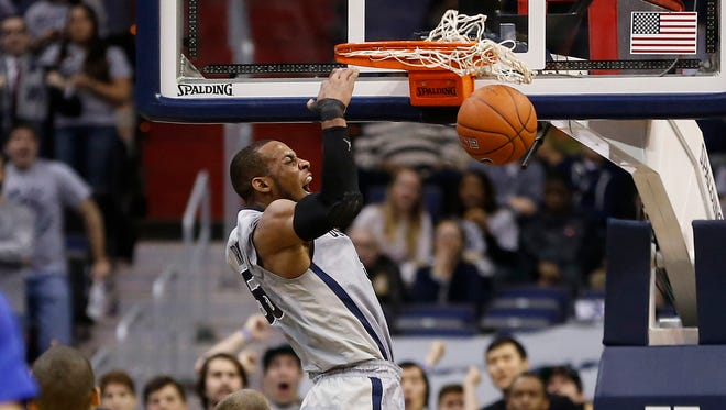 Georgetown's Jabril Trawick throws down an easy two against Creighton.