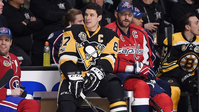 Jan 28, 2017; Los Angeles, CA, USA; Pittsburgh Penguins forward Sidney Crosby (87) sits next to Washington Capitals forward Alex Ovechkin (8) and Montreal Canadiens defenseman Shea Weber (6) during the skills challenge relay during the 2017 NHL All Star Game skills competition at Staples Center. Mandatory Credit: Kelvin Kuo-USA TODAY Sports ORG XMIT: USATSI-353852 ORIG FILE ID:  20170128_jel_ak6_052.jpg
