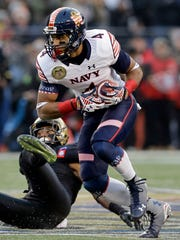 Navy wide receiver Jamir Tillman (4) cuts past Army