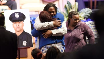 Detroit officer killed in crash saluted as 'warrior'